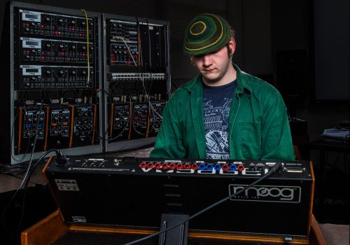 Student mixing music in the Bob Moog studio