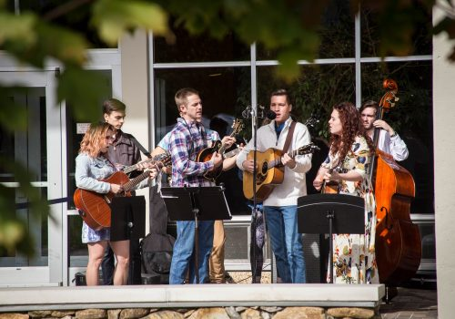 Bluegrass ensemble performing at Turning of the Maples at UNC Asheville